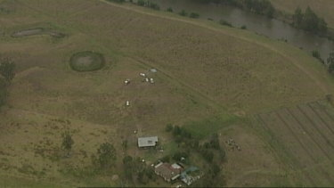 The crash site is in the middle of a field next to a property in Woodville.