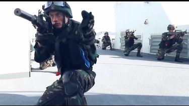 Screenshots from Chinese video showing thenew psychological tool in the Hong Kong crisis.