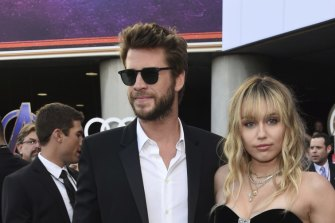 "Liam Hemsworth, left, and Miley Cyrus arrive at the premiere of ""Avengers: Endgame"" in Los Angeles in April."