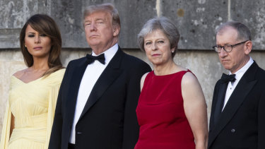 From left, first lady Melania Trump, President Donald Trump, British Prime Minister Theresa May, and her husband Philip May, watch the arrival ceremony at Blenheim Palace, in Blenheim west of London, England, Thursday, July 12, 2018.