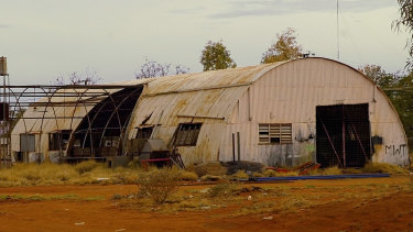 The white shed used as a painting room at  Papunya Tula, photographed when derelict in 2005.