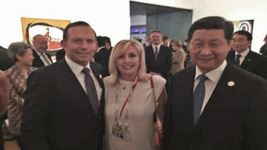 Former Prime Minister Tony Abbott with Christine Holgate, chief executive of Australia Post and Chinese President Xi Jinping at the G20 in the photo taken on Ms Holgate's smuggled iPhone.