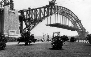 THEN Sydney Harbour Bridge under construction, taken from Dawes Point Reserve in the 1930s. The world's tallest steel arch bridge has come to represent Australia for people of all nations.