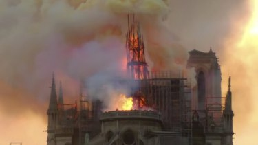 Flames and smoke rise from Notre-Dame Cathedral in Paris.