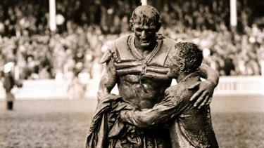 The gladiators, Norm Provan (St George) and Arthur Summons (Wests) leave a muddy SCG after the 1963 Rugby League Grand Final. Iconic rugby league photo on which the NRL trophy is based. SMH SPORT picture by JOHN O'GREADY