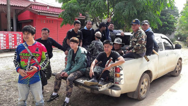 Members of the Thai military, Forest Rangers and birds' nest team at base camp.