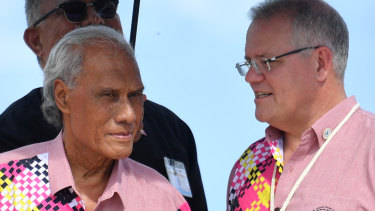 Tonga's late Prime Minister 'Akilisi Pohiva, left, with Prime Minister Scott Morrison in Tuvalu last month.