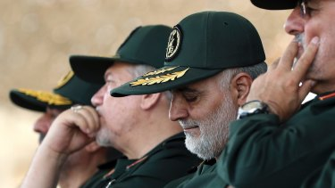 General Qassem Soleimani, centre, the head of Quds Force of Iran's Revolutionary Guard.