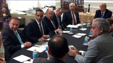 George Papadopoulos, second from left, sits at a table in March 2016 with then-candidate Donald Trump.