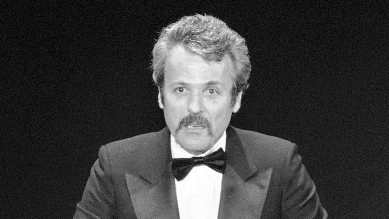 "William Goldman accepts his Oscar at Academy Awards in Los Angeles, for screenplay from other medium for ""All The President's Men."" , 1977."