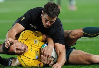 Quade Cooper feels the love from Richard Kahui in 2011.