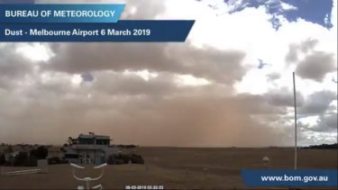 The raised red dust reduced visibility at the airport briefly.