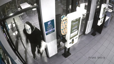 A still from CCTV footage of a man wanted by ACT Police in relation to an aggravated robbery on Monday.
