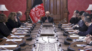Afghan President Ashraf Ghani, centre, speaks to US peace envoy Zalmay Khalilzad, third left, at the presidential palace in Kabul on Monday.