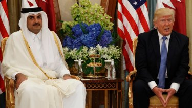 Qatar's ruler Sheikh Tamim bin Hamad al-Thani, pictured meeting Donald Trump in 2017, was targeted by the UAE spying operation.