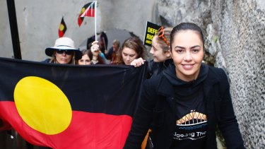 Cheree Toka and fellow demonstrators carried an Aboriginal flag up the steps of the Sydney Harbour Bridge during a demonstration in Sydney in 2018.