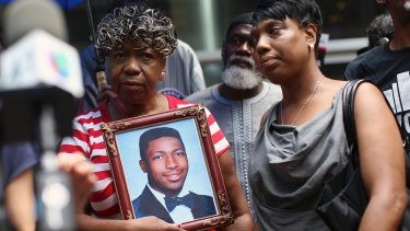 Gwen Carr, mother of Eric Garner, holds a photo of her son in 2015.