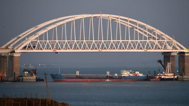 A large cargo ship under the bridge over the Kerch Strait blocked access to the Azov Sea on Sunday.