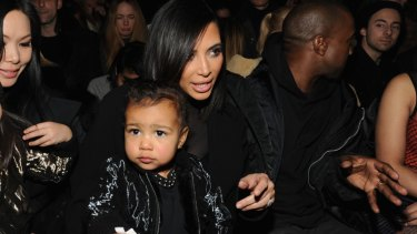 Officially cute: North West with mother Kim Kardashian and father Kanye West at New York Fashion Week.