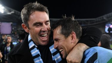 Happy days: Brad Fittler and Mitchell Pearce celebrate a remarkable Origin series win. But it wasn't all smiles for the Blues coach.