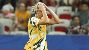 Australia's Alanna Kennedy leaves the pitch after receiving a red card.