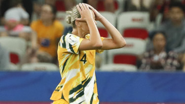 Australia's Alanna Kennedy leaves the pitch after receiving king a red card.