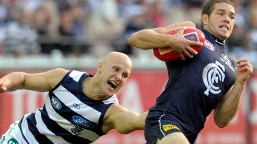 Gary Ablett tackles Aaron Joseph in 2010.