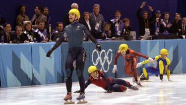 Steven Bradbury crosses the line in first place in the men's 1000m speed skating final during the 2002 Winter Olympics.