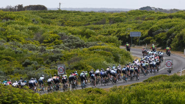 The peloton makes its way past the Bay Of Martyrs.