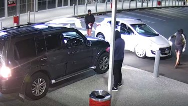 The two stolen cars and four men at the Mount Cotton supermarket.