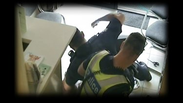 Footage showing police violently arresting a Sudanese-Australian man after a chemist robbery.