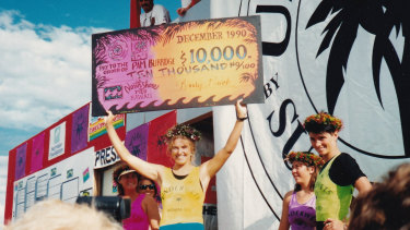 Pam Burridge collects a winner's cheque in Girls Can't Surf.