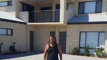 Glen Wilkins outside his property.