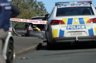 Armed police at the scene after the offender fled the scene in West Auckland on Friday morning.