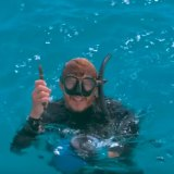 After several free diving attempts to help the manta ray, Mr Wilton rises triumphantly from the ocean hook in hand.