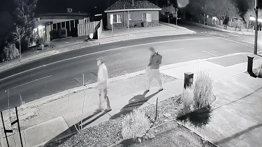 Police wish to speak to the masked man in the foreground of this CCTV footage, pictured with the victim.