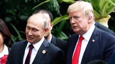 Russian President Vladimir Putin and Donald Trump arrive for the 'family photo' at the APEC forum last year.