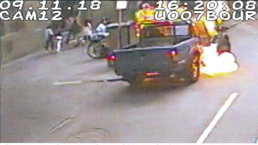 CCTV footage of a fireball surrounding the passenger compartment.