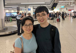 Adrian Liu and his mother Shirley Luo after Adrian arrived home from Christmas Island.