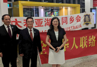 MP Gladys Liu and members of the Chinese community wait at Melbourne Airport for the flight from Christmas Island.