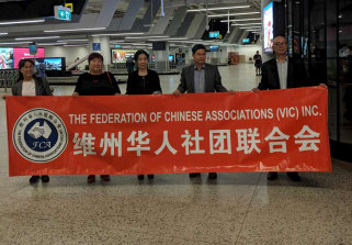 Members of the Chinese community wait at Melbourne Airport for the flight to arrive from Christmas Island.