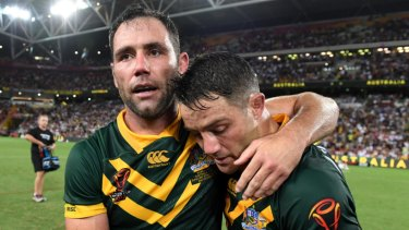 Better days: Smith and Cronk celebrate a Kangaroos' win in 2017.