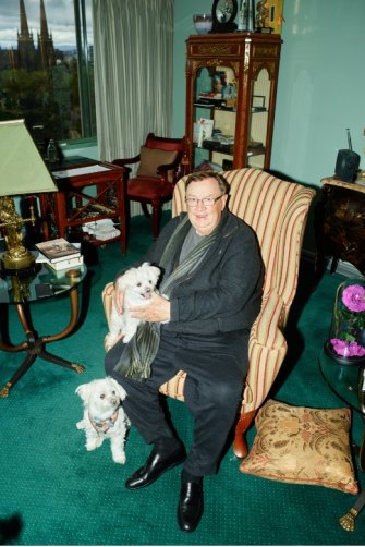 With pets Lilly and Lucy at his Melbourne home, an amalgamation of five apartments.