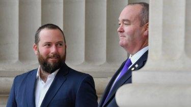 Jeff Bourman (right) welcomes Ricky Muir to the Shooters, Fishers and Farmers Party.