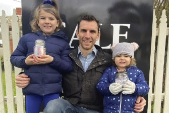 Chris Bellesini with his two young daughters Mackenzie and Genevieve.
