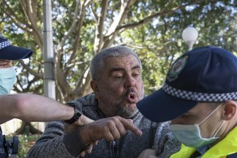 A man is arrested by police after attending a protest in Sydney's Hyde Park on Saturday.