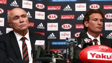 Essendon coach James Hird (right) and CEO Paul Little face the media in March 2015.
