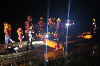 Fire & Rescue NSW crews found snakes in the boats as they rescued a family in Sancrox, NSW.