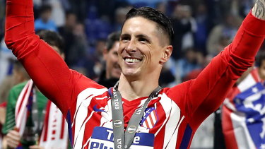 Gone to highest bidder: Fernando Torres celebrates after winning the UEFA Europa League final with Atletico Madrid\'s over Olympique Marseille in May.
