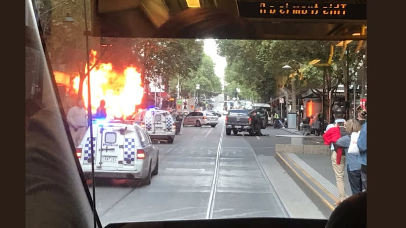 Car crashes, bursts into flames on Bourke Street
